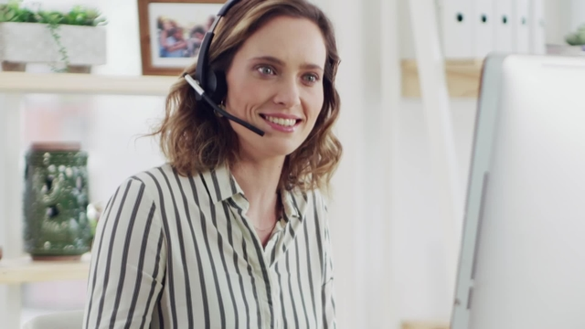 Woman on a headset working on a PC
